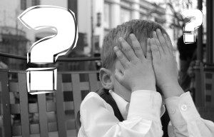 Canva - Kid Covering his Eyes Next to a Question Mark